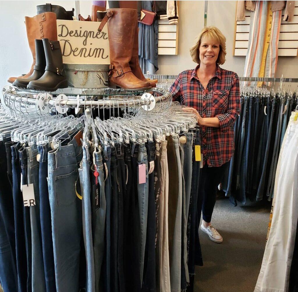 designer denim clothes on rack